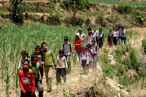 Students of Shree Balephi Secondary School go back home from the school on the first day of school