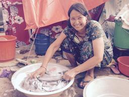 Woman washes clothes in Bhaktipur with soap from UNICEF hygiene kit