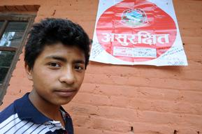 Praful Maharjan,14, stands in front of his classroom in Shree Rudrayanee Secondary School in  Khokana