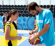 The Ambassador J.M. Calderon signs of the participants` basketball