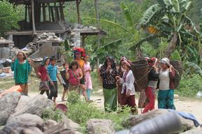 Men and women gather at the relief item distibution point in Baluwa