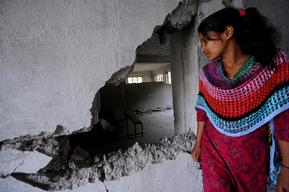 Laxmi Giri, 15, looks into her destroyed classroom of Balefi Secondary School in Balefi