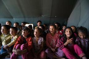 Jamuna Nepali, 9, her sister Ganga, (second from right), and other children attend a UNICEF-supported Child Friendly Space