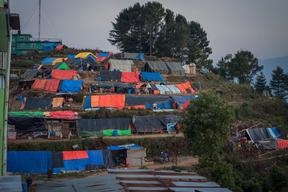 Evening falls on a camp for earthquake-displaced families located on a windswept ridge above the town of Charikot, Dolakha District