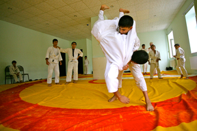 Two boys doing judoat the Youth Center