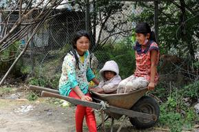 Children of Jhirpu village in Sindhupalchowk playing on a wheelbarrow